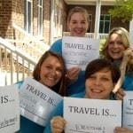 Our Chamber & CVB staff posed with their travel is...signs.