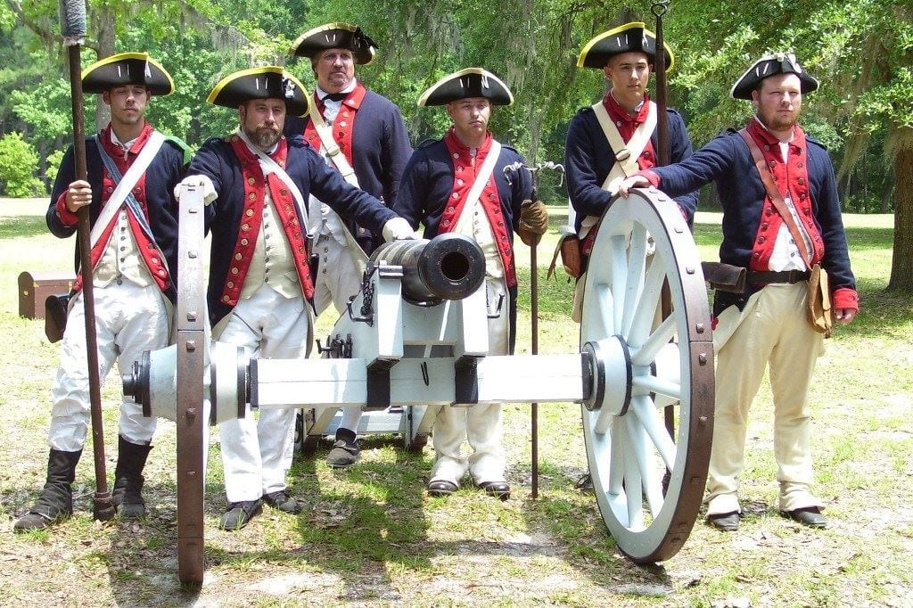Actors at Fort Morris posing with a cannon