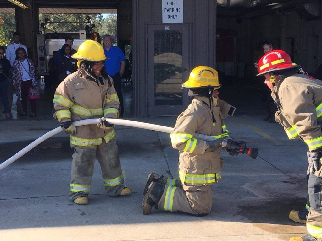 YALL Hinesville Session with young people handling a firehose.