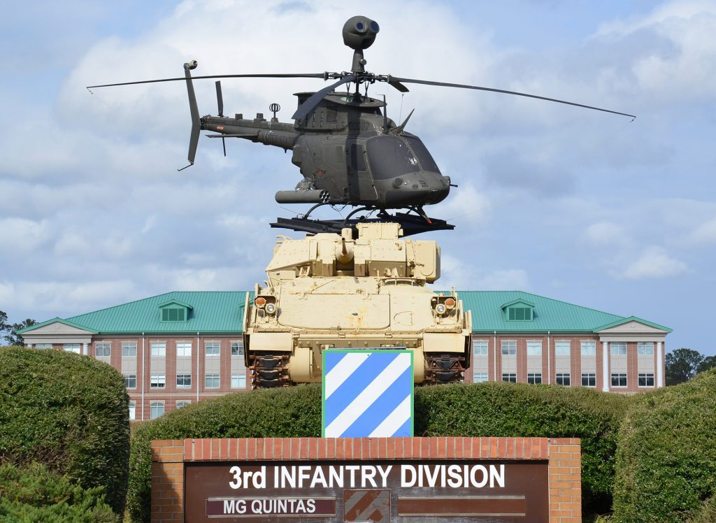 Fort Stewart entrance with tank and helicopter.
