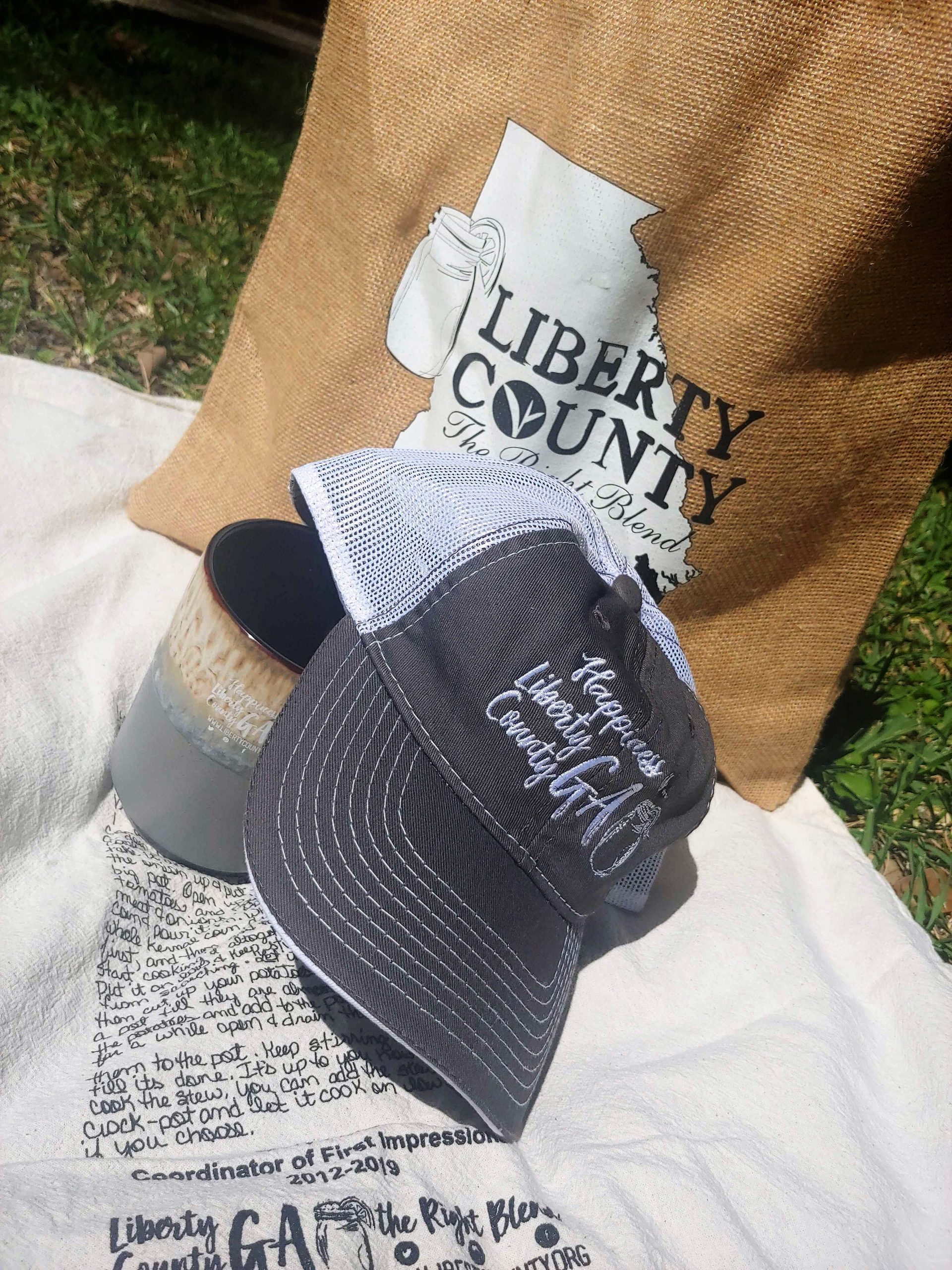 Hat and mug on picnic blanket